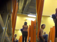 Few women caught on a hidden camera undressing in a locker room