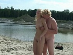 A pair of horny swingers on a nude beach