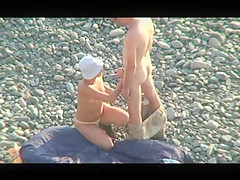 Voyeur on public beach. Oral sex