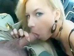 Beautiful blond gives great blowjob in public parking lot
