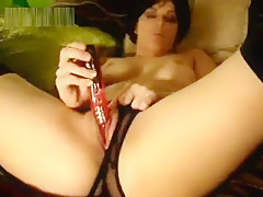 Masturbating with her dildo (from the days of dial-up)