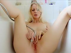 Big tit blonde in tub rubs her wet pussy