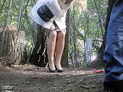 Girl ###s with her boyfriend in the bushes of a park