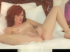 Redhead MILF plays with her nipples and pussy