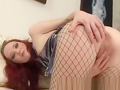 Exciting Redhead In Fishnet Stockings