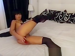 Hot Brunette In Stockings Fingering And Toying Pussy