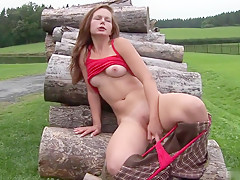 A Sexy European Brunette, Wearing A Tank Top And Riding...