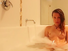 Teen masturbating in the bathtub