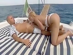 Blonde Sucks Cock Outside On The Water