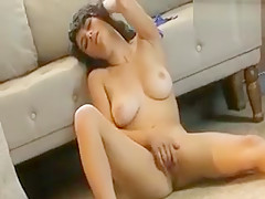 Raven Rockette With Big Dcup Tits Sits Against Couch And