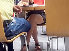 her sexy legs hot feets under table