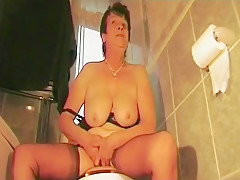 Naughty old British granny catches her son filming her pissing.