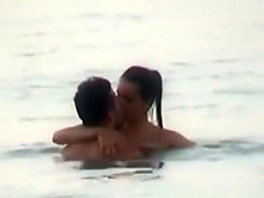 Couple having sex in the water