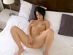 Sexy girl masturbating on her bed