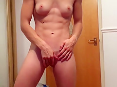 Fit girl plays with dildo