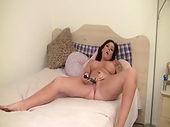 Busty honey masturbates on bed