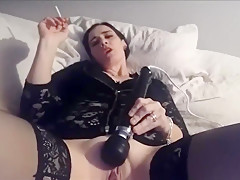Kinky Milf Masturbating While Having A Cigarette