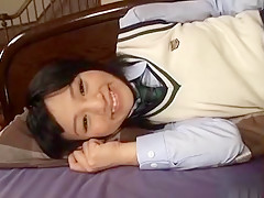 Sexy Schoolgirl Shows Her Bushy Pussy And Sucks On A Toy