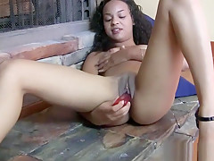 Desert Cuties gets toy inside her cunt against the fireplace