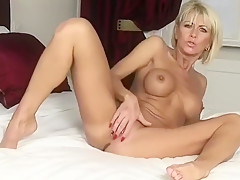 Cathy E plays with her pussy