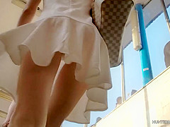 Cute blonde in white dress upskirt