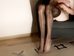 Erotic Striptease in Brown Lace Tights