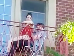 Shameless couple on balcony