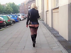 Public walk in boots and vinyl skirt