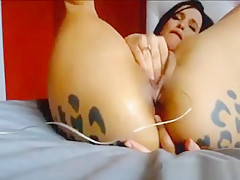 Webcam Slut With A Leopard Ass Tattoo Fingering Her Holes