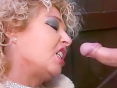 Slut gives a blowjob outdoors