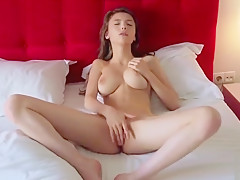 Girl caresses her pussy