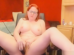 Curvy Redhead Plays With Her Unshaved Cunt