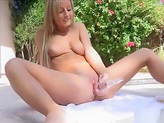Beauty Spreads Legs And Begins Stimulating Her Clitoris