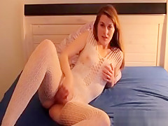 Hot Brunette In A White Fishnet Outfit Rubbing Her Pussy