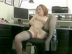Redheaded Milf Amber Masturbates In Her Office
