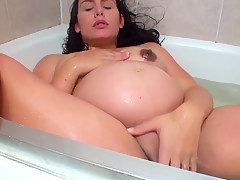 pregnant brunnet have a shower in a badtub (mother of love)
