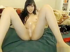 Asian Nerd Having A Dildo