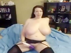 Lovely Lilith masturbates with a vibrator and her huge tits bounce