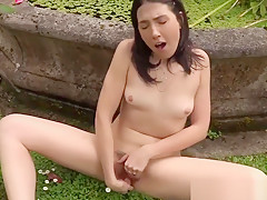 Brunette outdoors fingering cunt