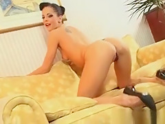 Glam Whore Rubs Her Pussy