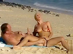 Blonde bimbo makes a hot manual stimulation at the beach