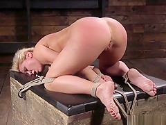 Busty Sub Flogged While Being Restrained