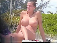 Tanned pierced marvelous babe getting recorded on the nudist beach