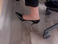 co worker with nylon socks and high heels.
