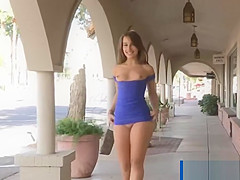 Brunette flashing and showing upskirt pussy on street
