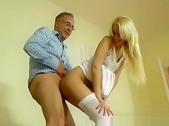 Older guy fucks and gets sucked by babe in stockings