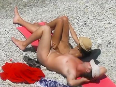 Nude beach relaxation and gentle penis stroking