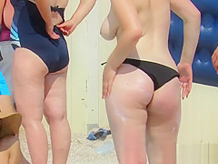 Topless Teens Tanning At The Beach