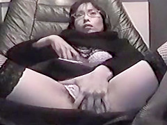 asian milf at porn store wanking off in video booth with dildos