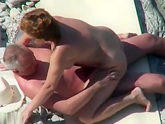Mature nudist couple caught fucking at the beach
